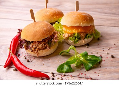 Delicious burgers with shredded meat and vegetables