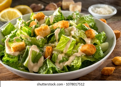 Delicious caesar salad with parmesan cheese, homemade croutons and dressing.
