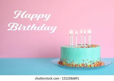 Delicious cake with candles and text Happy Birthday against pink background