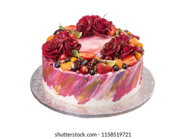 Delicious cake decorated with flowers and fruits. On birthday.
