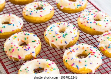 Delicious cake donuts with white frosting and tasty sprinkles make a great breakfast treat