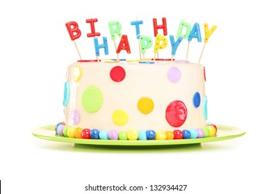 Delicious cake with happy birthday candles, isolated on white background