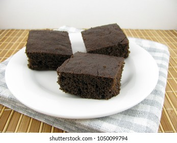 Delicious cake on a carob base on a plate
