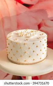 Delicious cake. White Cream Icing Cake with and White Chocolate. Wedding cake.