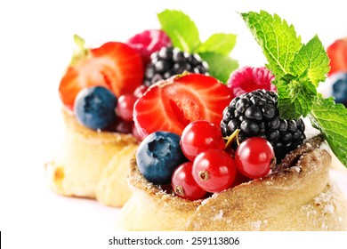 delicious cakes with strawberries, raspberries, blueberries, cherries and blueberries