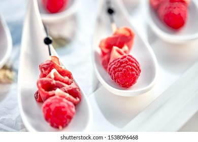 Delicious canapes hamon with raspberries. Concept of food, restaurant, catering, menu.