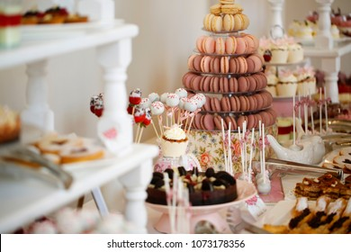 Delicious candy bar with macarons, cupcakes, cake pop and other sweets