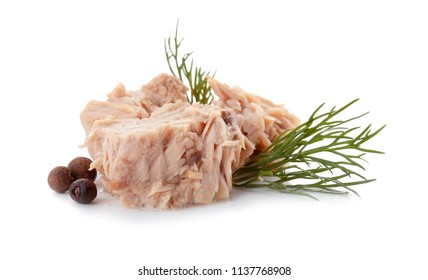 Delicious canned tuna chunks on white background