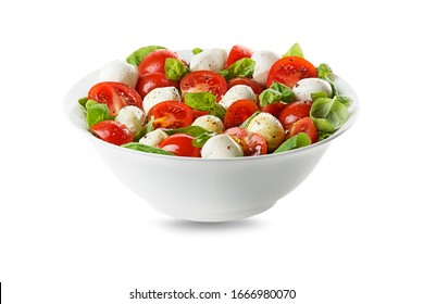 Delicious caprese salad with ripe tomatoes and mozzarella cheese with fresh basil leaves. Italian food. Salad with mozzarella, tomatoes, basil, salt, black pepper, olive oil