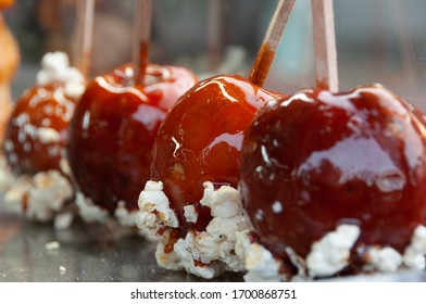 Delicious caramelized or glazed lollipop apples at a street stall