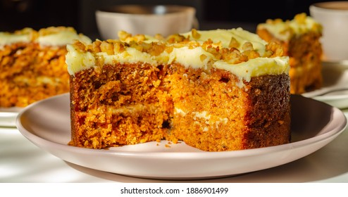Delicious carrot cake filled and topped with cream cheese buttercream and decorated with walnuts, bakery