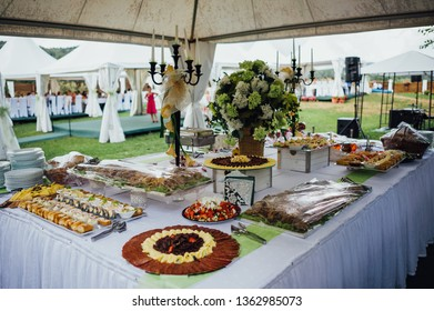 Delicious catering setting tables and food