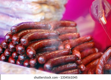 Delicious charcoa fried grilled sausages photographed close up