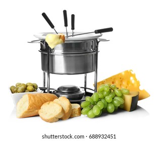 Delicious cheese fondue in pot and products on white background
