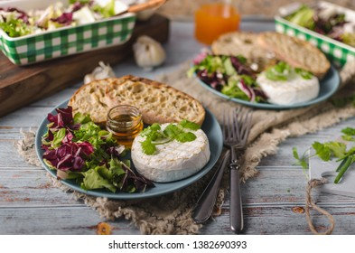 Delicious cheese, fresh salad and herbs with honey