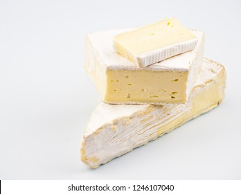 Delicious cheese with white mold. Soft Dijon-Brie. A whole piece and cutting, on a white background, close-up
