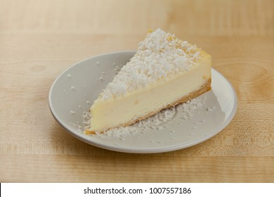 delicious cheesecake with coconut on a plate