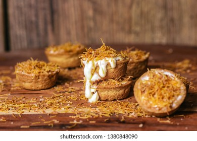 Delicious cheesecake cookie cups baked in a muffin pan. Homemade cookies with cream cheese filling and kataifi dough on the top. Traditional Middle Eastern dessert, Palestinian dessert. - Image
