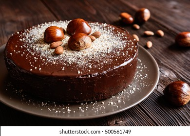 Delicious chestnut cake with almonds and chocolate glaze