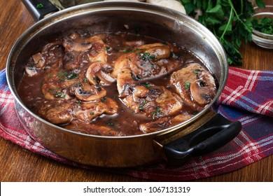 Delicious chicken marsala on frying pan. Italian cuisine