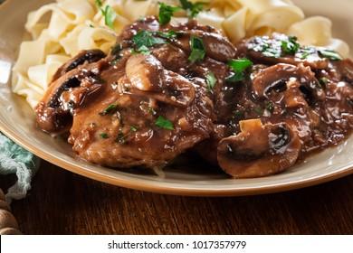 Delicious chicken marsala served with fettucine pasta. Italian cuisine