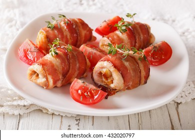 Delicious Chicken rolls with cheese and bacon on a plate close-up. horizontal