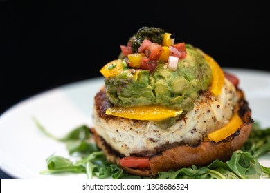 Delicious Chicken Sandwich Decorated with Orange bell peppers, Tomatoes, Guacamole and Pesto