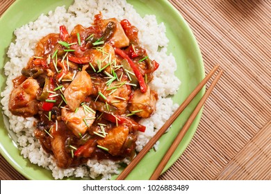 Delicious chicken in sweet and sour sauce served with rice. Top view