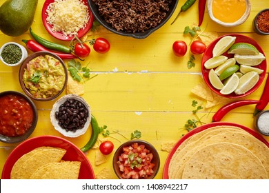 Delicious Chilli con Carne ingredients waiting to be prepared. Placed on yellow wooden table. Top view with place for text in the middle.
