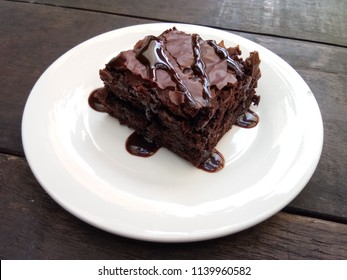 Delicious chocolate brownies on white plate.