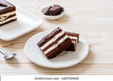 Delicious chocolate cake with almonds on plate