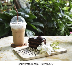 Delicious chocolate cake and cappuccino coffee