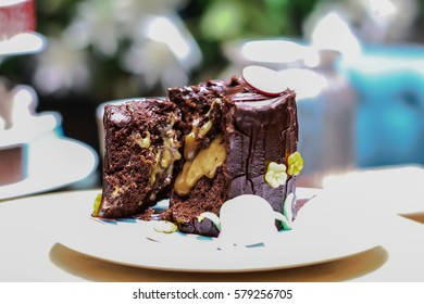 Delicious chocolate cake look like timber. And it shows caramel pouring in cake