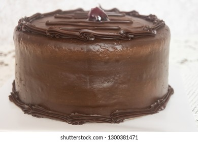 Delicious chocolate cake with a strawberry