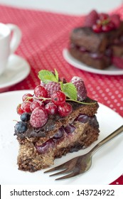 Delicious chocolate cake with strawberry and raspberry and cherries