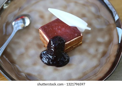 Delicious chocolate cake with white chocolate pen and jam take a close-up picture