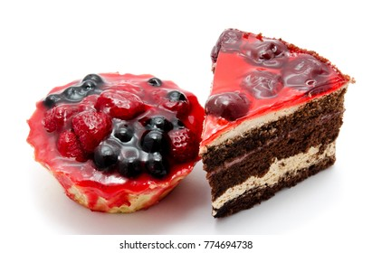 Delicious chocolate cakes pastry with fruit cherry raspberry currant isolated on a white background