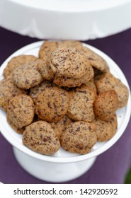 Delicious chocolate chip cookies on table
