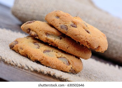 Delicious chocolate chip cookies on wooden table