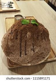 delicious  chocolate kakigori on the wooden table