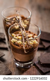 Delicious chocolate mouse in a bowl with ingredients