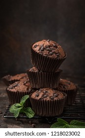 delicious chocolate muffins on  dark background, selective focus
