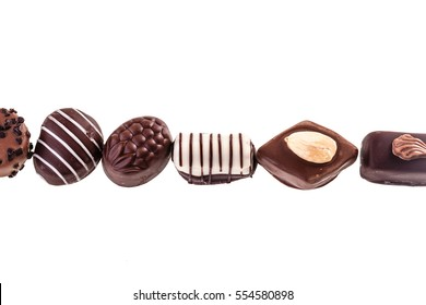 Delicious chocolate pralines isolated over a white background