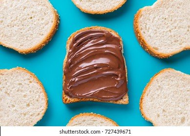 Delicious chocolate sandwich and pieces of fresh bread. Top view, Flat lay