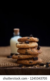 Delicious chocolatechip cookies with milk background.