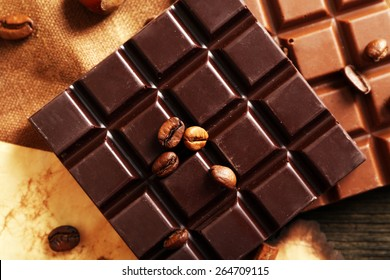 Delicious chocolates with nuts spices on table, closeup
