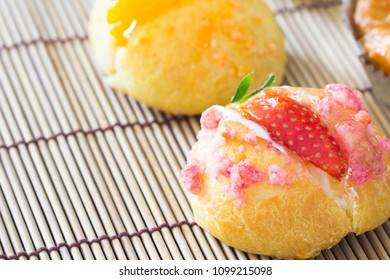Delicious choux cream on plate