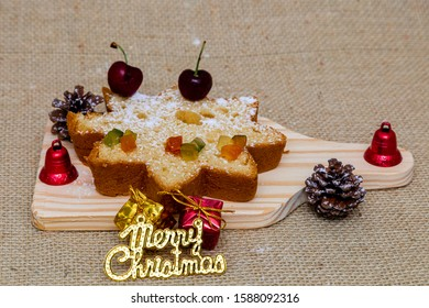 Delicious Christmas bread with icing sugar and cherries to go with it. Christmas decoration.