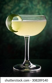 A delicious classic style daiquiri with rum, lime juice, and sugar.