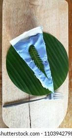 A delicious coconut cake on the banana leaf.